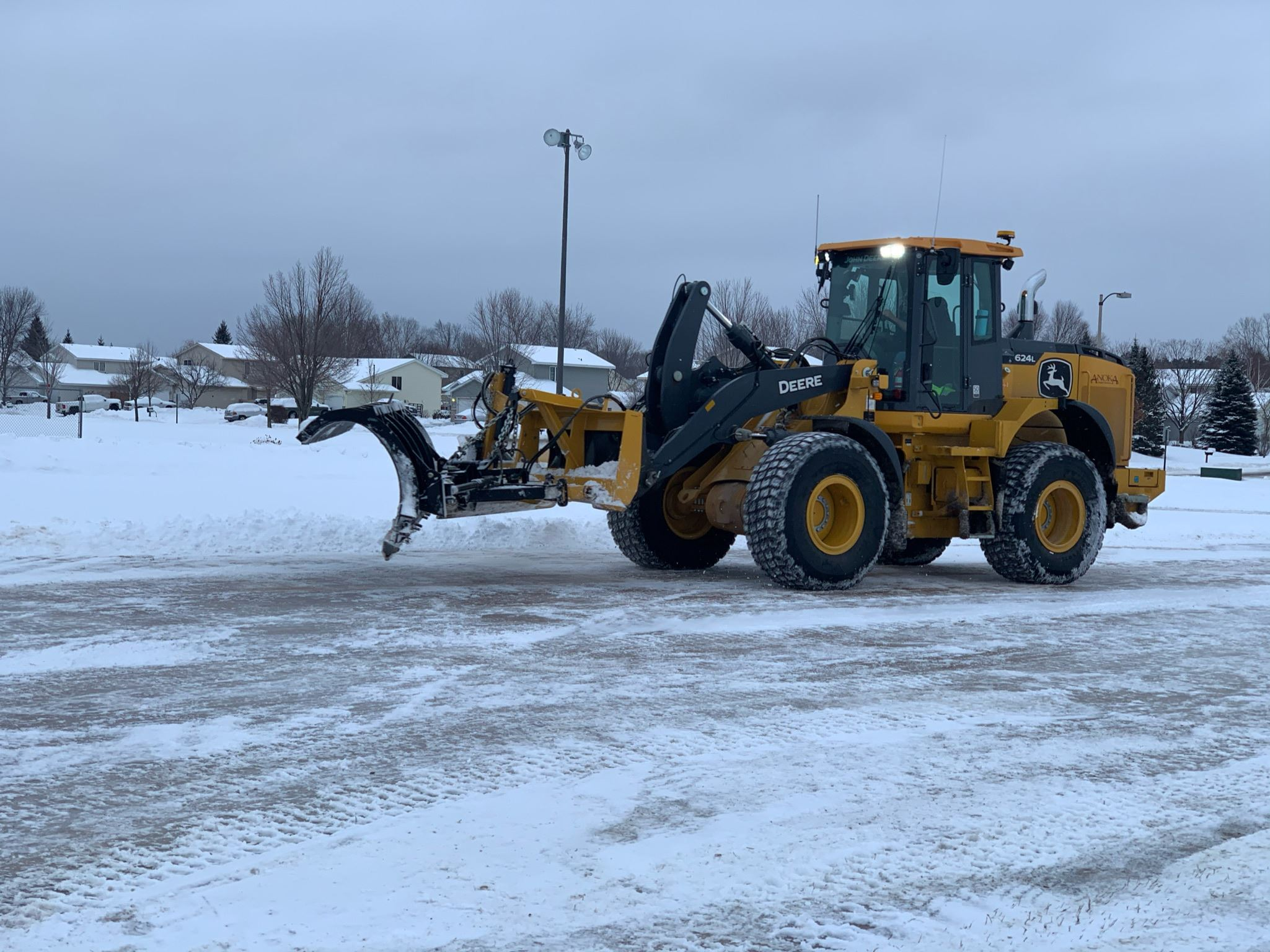 Loader Clearing Ice