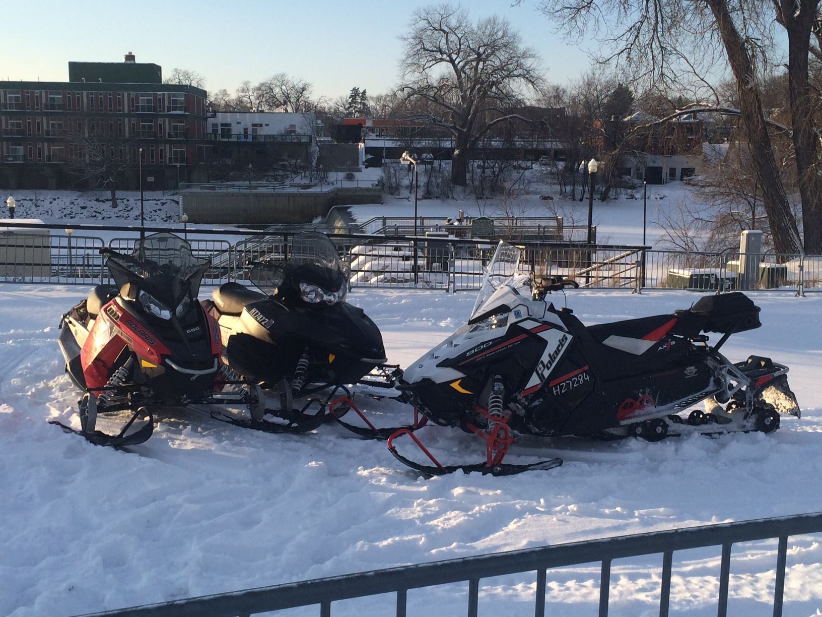 Three Snowmobiles Parked by Each Other