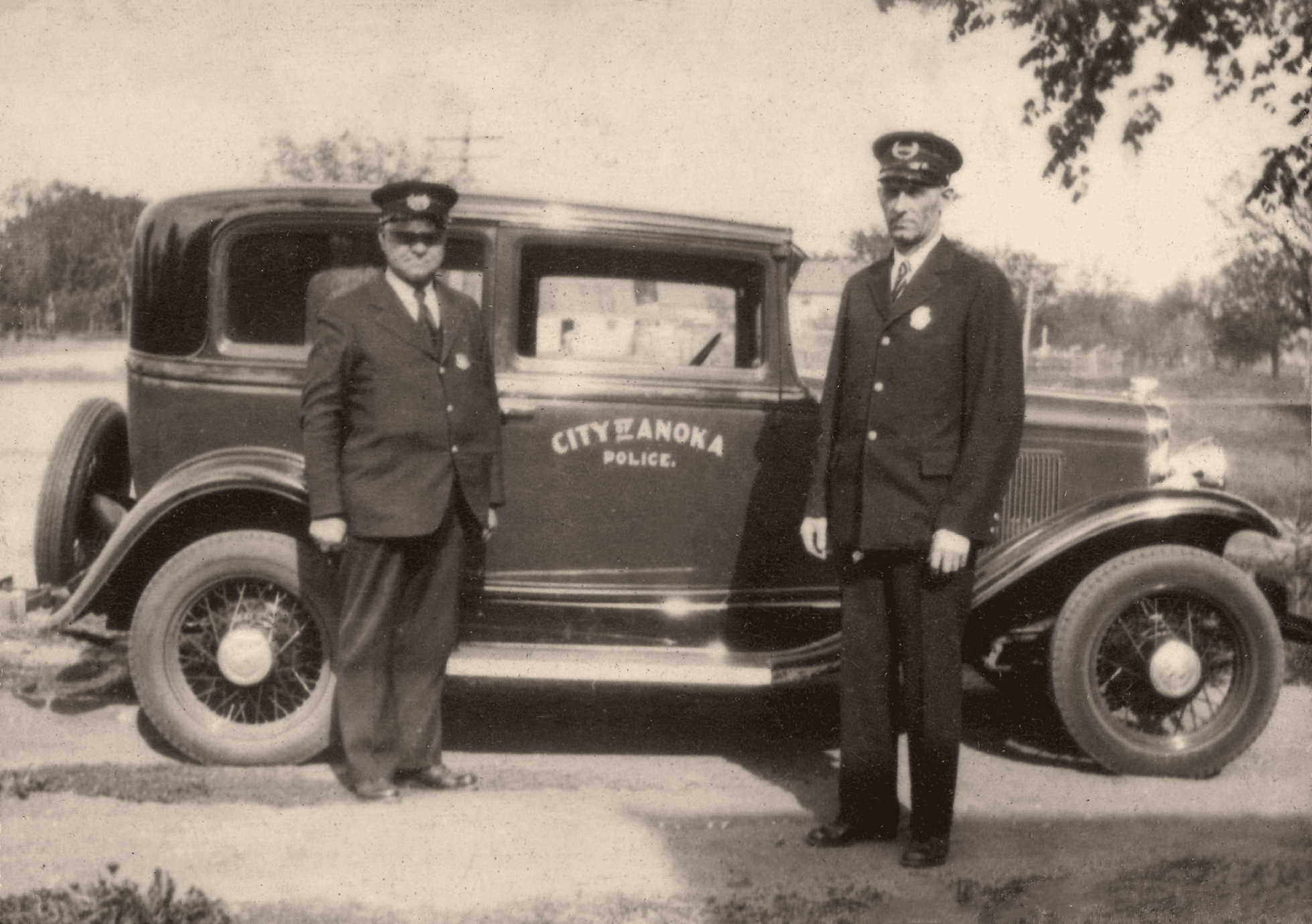 Chief John Melberg and Patrolman Jack Larson with 1930 Pontiac Squad Car
