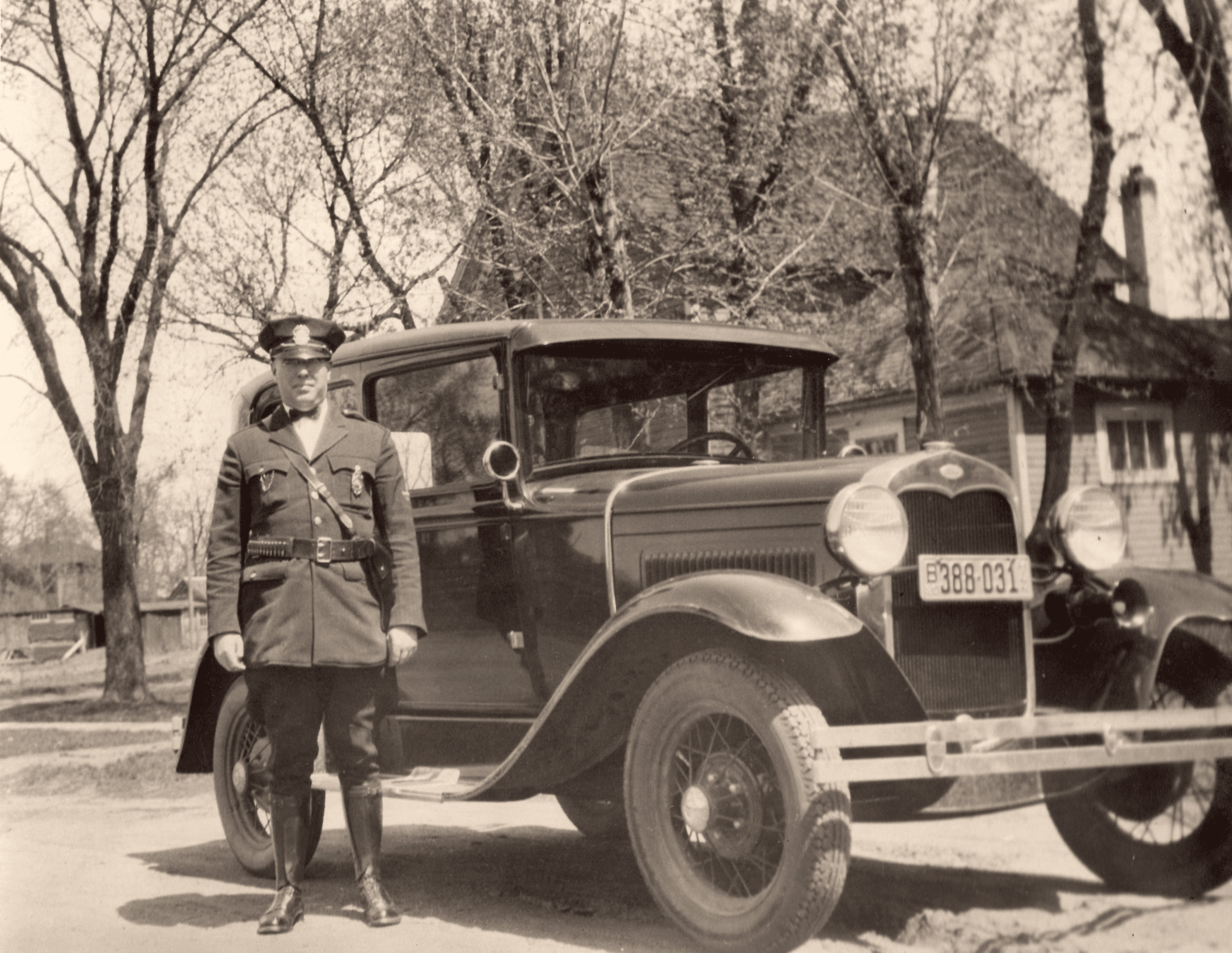 Police Officer with 1935 Ford Squad Car